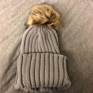 Grey puff ball winter hat